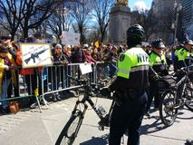 Bike Cops, March for Our Lives, Protest, Columbus Circle, NYC, NY, USA. The NYPD Strategic Response Group SRG Bicycle Squad stands between marchers and Trump Royalty Free Stock Photo
