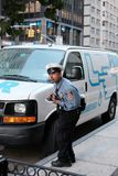 NYPD traffic officer seen issuing a parking ticket in New York City, stock images