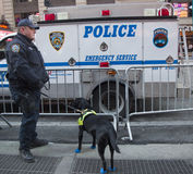 NYPD transit bureau K-9 police officer and K-9 dog providing security on Times Square during Super Bowl XLVIII week in Manhattan Royalty Free Stock Photos