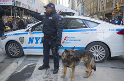 NYPD transit bureau K-9 police officer and K-9 German Shepherd providing security on Broadway during Super Bowl XLVIII week. NEW YORK - JANUARY 30 NYPD transit stock images
