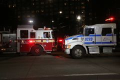 NYPD truck and FDNY firetruck at the crime scene near a terror attack site in lower Manhattan. NEW YORK - OCTOBER 31, 2017: NYPD truck and FDNY firetruck at the royalty free stock image