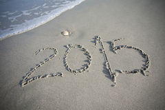 Nytt år 2015 i sanden på stranden Arkivfoto