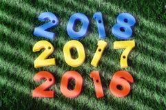 Nytt år 2016, 2017 och 2018 färgrika nummeridé Arkivfoton