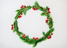 Nytt år och julkrans - granträd och mistel på vit arkivfoto