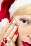 Nytt års manikyr och makeup Arkivfoto
