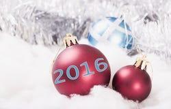 Nytt års prydnader röd 2016 Arkivfoto