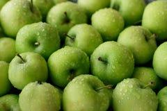 Nytt grönt för äpplen rambruk mycket som bakgrund Arkivbild