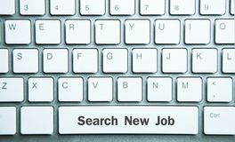 Nytt jobb för sökande med tangentbordet arkivfoto