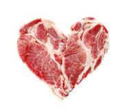 Nytt rått kött i form av hjärta arkivfoto