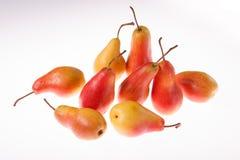 Nytt, saftigt ljust päron på en vit glödande bakgrund Fotografering för Bildbyråer