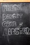 Nytt tecken för svart tavla för för Dorset krabba och hummer Royaltyfri Fotografi
