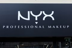 Nyx Cosmetics logo on one of their retailers. Nyx is an American cosmetics company specialized in makeup. Picture of a sign with the Nyx logo in their main shop royalty free stock photo