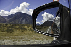 Nz road mirror view. Nz road in the mountains, scenic view Royalty Free Stock Photography