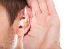 Oído con el audífono Imágenes de archivo libres de regalías