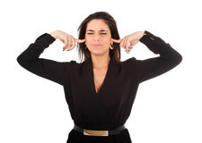 Oídos cerrados de la mujer con los fingeres imágenes de archivo libres de regalías