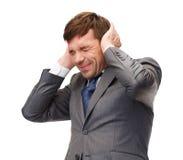 Oídos cerrados subrayados del buisnessman o del profesor Imagen de archivo libre de regalías
