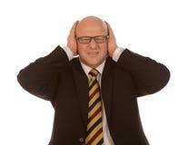 Oídos de la cubierta del hombre de negocios Imagen de archivo