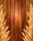 Oídos del trigo en fondo de madera Fotos de archivo