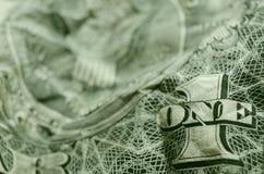 ОДНО и 1 на winkled американской долларовой банкноте стоковое фото rf