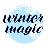Winter magic hand written phrase. Abstract blue snowball background. royalty free illustration