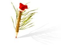 Ołówek drzewa w Święty Mikołaj kapeluszu Zdjęcie Royalty Free