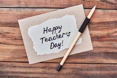 Ołówek, szczęśliwa nauczyciela ` s dnia karta fotografia stock