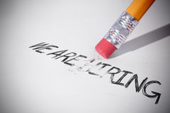 Ołówek wymazuje słowo zatrudniamy Fotografia Royalty Free
