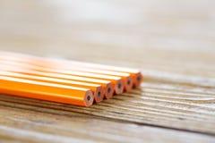 Ołówki kłama na drewno stole Obrazy Royalty Free