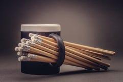 Ołówki z gumką i czarną filiżanką Zdjęcia Royalty Free