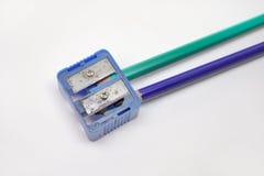 Ołówkowe ostrzarki i dwa ołówka w one zbliżenie obrazy stock