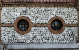 Ośniedziała fasada z round okno Obraz Stock