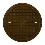 Ośniedziała manhole pokrywa odizolowywająca na bielu Fotografia Stock