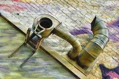 Ośniedziałego metalu wydmuchowa drymba na cegła domu Obrazy Stock