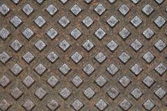 Ośniedziały manhole wzoru zbliżenie, pożytecznie jako tło zdjęcie stock