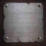 Ośniedziały metalu talerz z poszarpanym krawędzi tłem Obraz Royalty Free