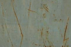 O?niedziali scrathes na metalu malowali w b??kitnym kolorze zdjęcia stock
