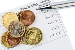 Oświadczenie konto i monety zdjęcie stock