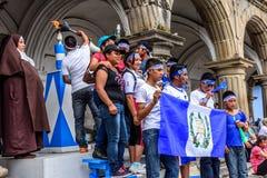 Oświetleniowa pochodnia & pozować dla fotografii, dzień niepodległości, Antigua, G zdjęcia stock