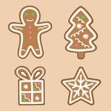 O ícone do presente da árvore de Natal do floco de neve do homem de pão-de-espécie ajustou-se no creme Fotos de Stock Royalty Free