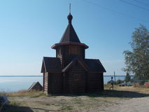 Одинокая церквушка у озера. You want to go there, in a corner of pristine nature, where royalty free stock photo