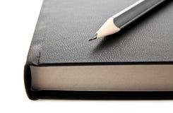 Ołówek i notatnik Zdjęcia Stock