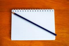 Ołówek na notatniku Obrazy Stock