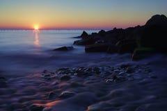 Cores do por do sol na água Fotografia de Stock Royalty Free