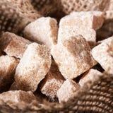 O açúcar mascavado cuba o close up Fotografia de Stock