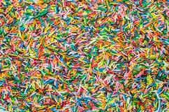 O açúcar polvilha os pontos, decoração para o bolo e o bekery, muito polvilha como um fundo Imagens de Stock