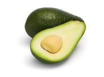 O abacate inteiro e halved isolou-se fotos de stock royalty free