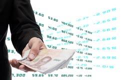 O acionista faz o dinheiro da bolsa de valores foto de stock royalty free