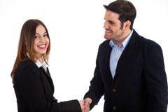 O acolhimento do homem de negócio mulheres agita perto as mãos Imagens de Stock Royalty Free
