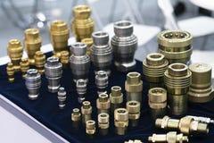 O acoplamento rápido industrial faz por de aço, inoxidável, de bronze imagem de stock