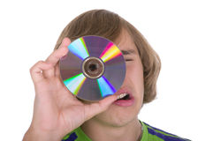 O adolescente com um disco ótico foto de stock